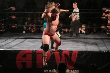 Levi Shapiro is knocked off the ring apron.